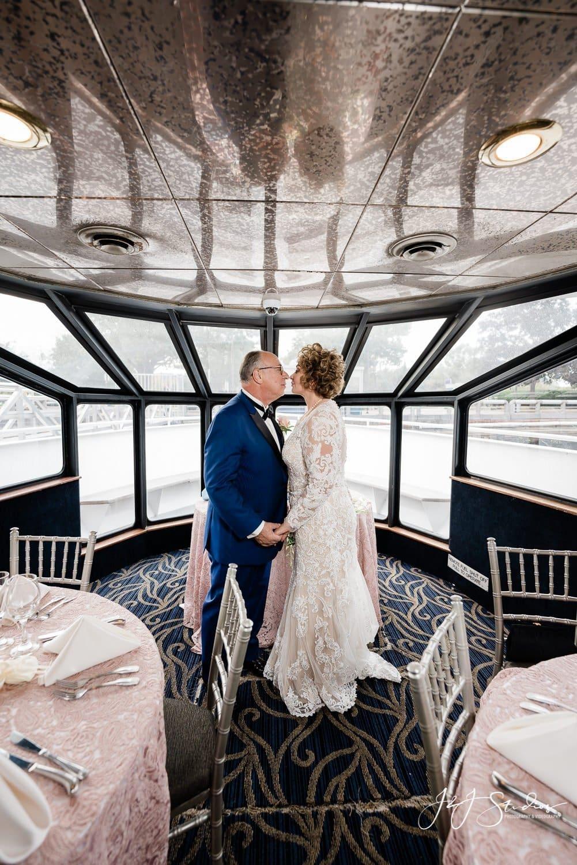 couple kisses on board freedom elite
