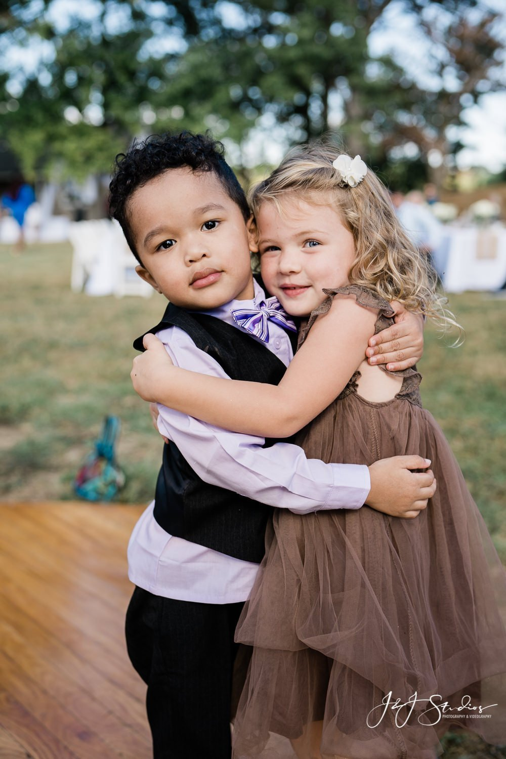 ring bearer and flower girl hug baltimore home wedding