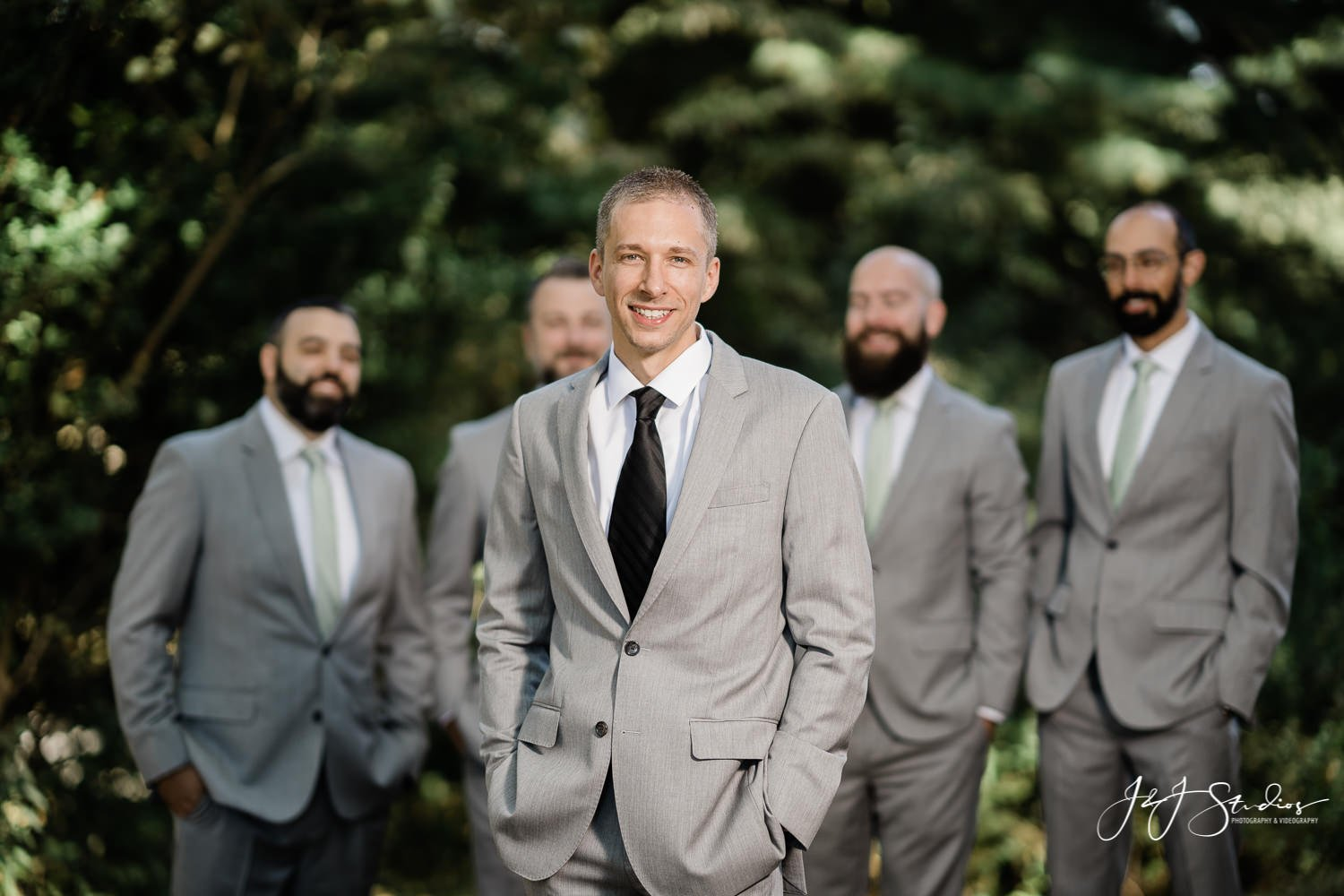 groom and groomsmen poses by john ryan J&J Studios