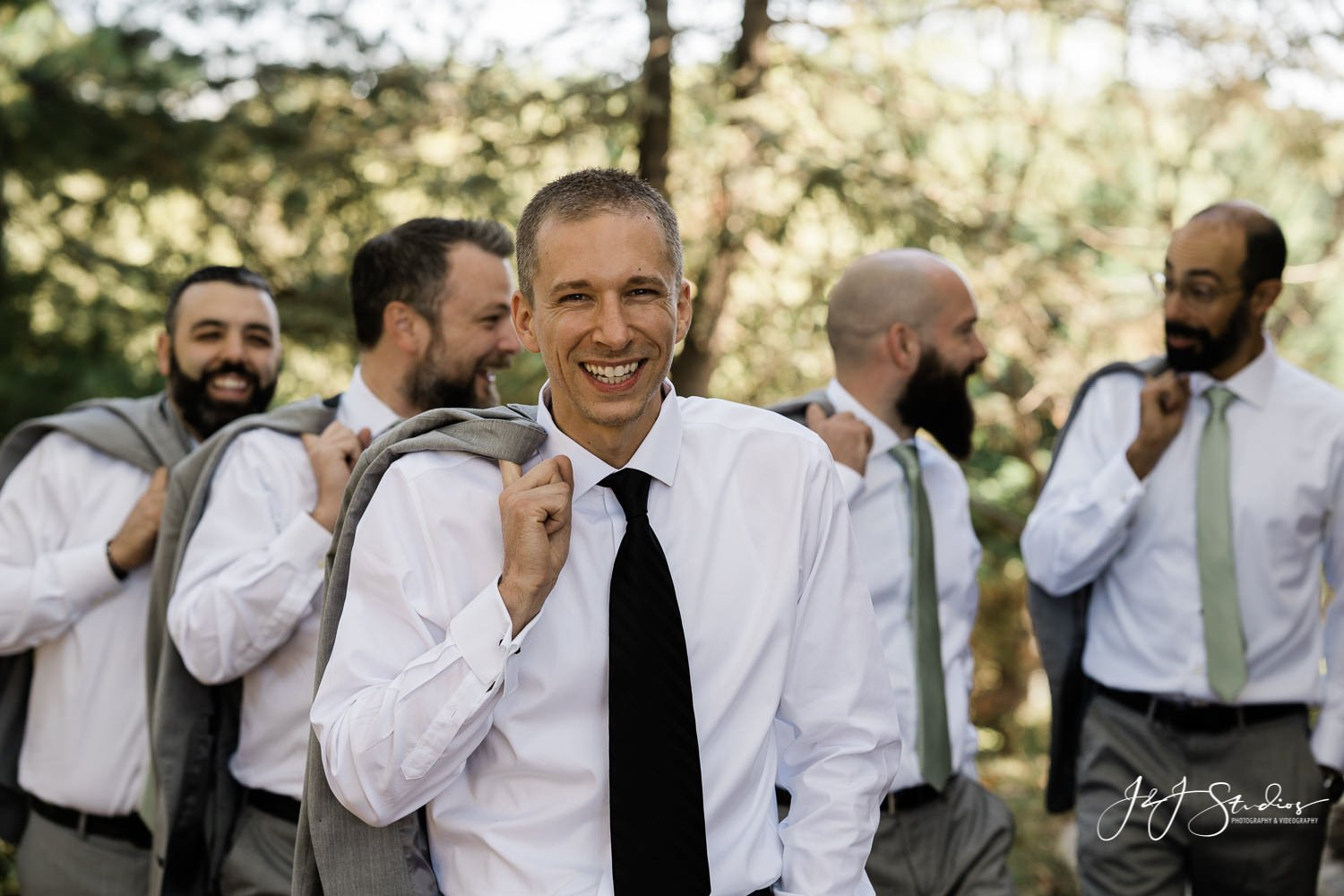 groom with jacket over shoulder