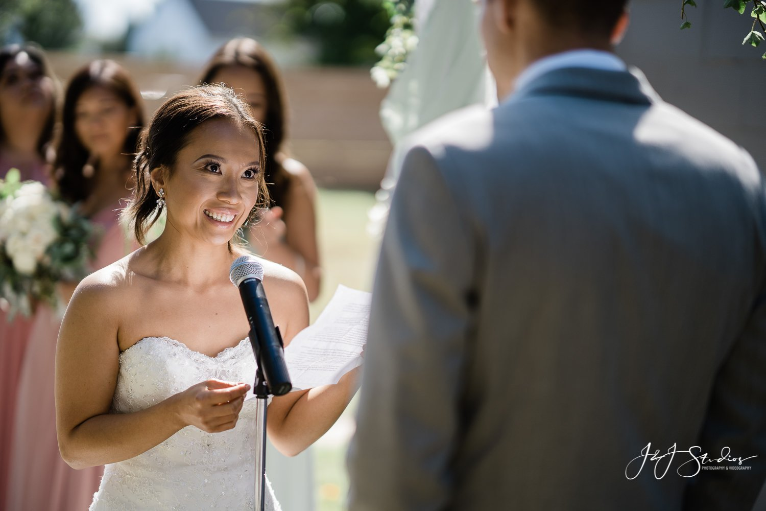 bride says her vows during baltimore backyard wedding