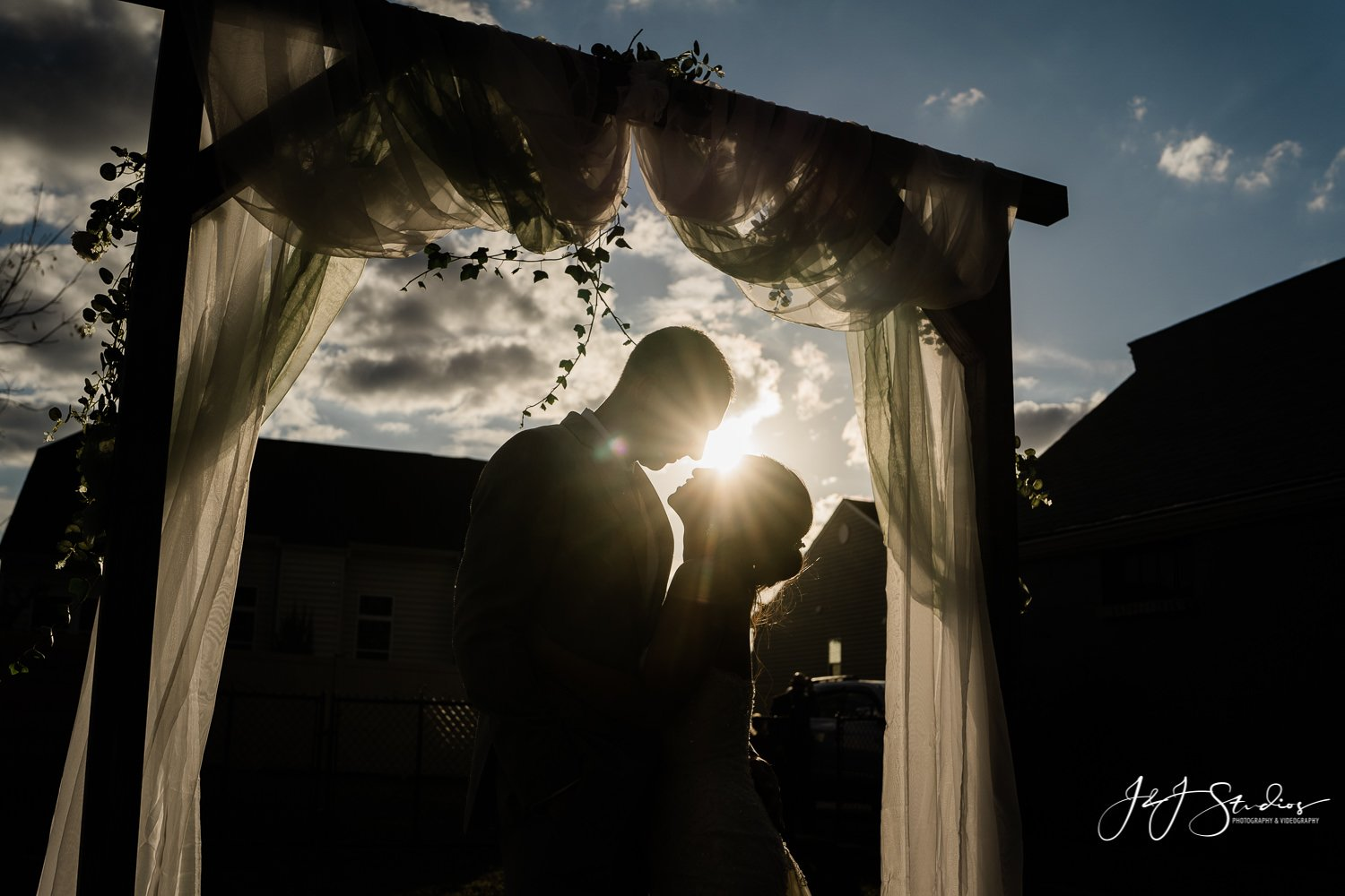 bride and groom silhouette at baltimore backyard wedding