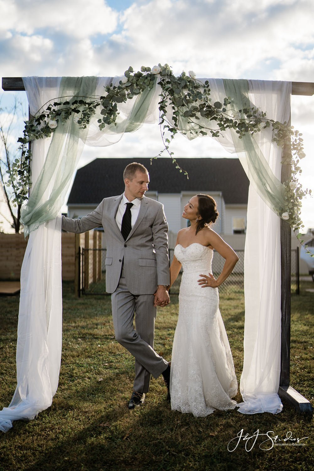 bride and groom at DIY arbor