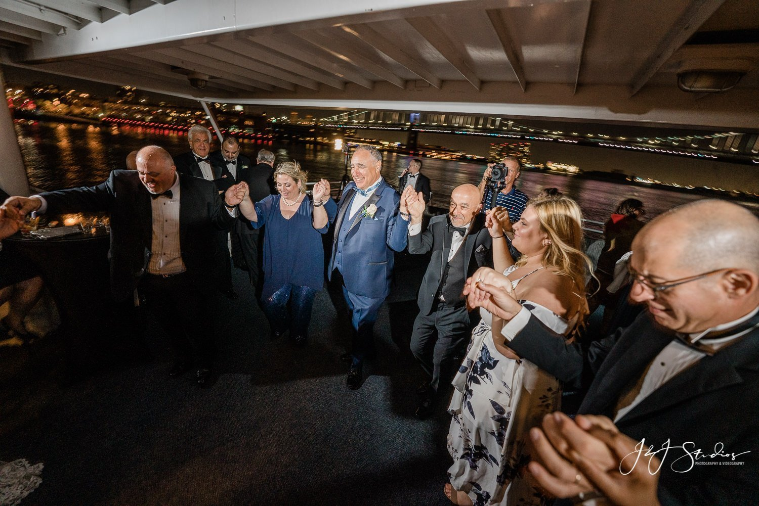 groom and guests dancing philly yacht wedding