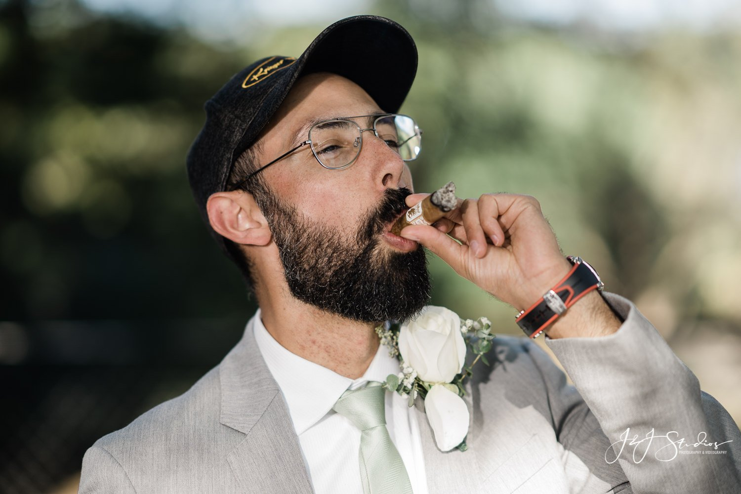 groomsmen smoking undercrown cigar