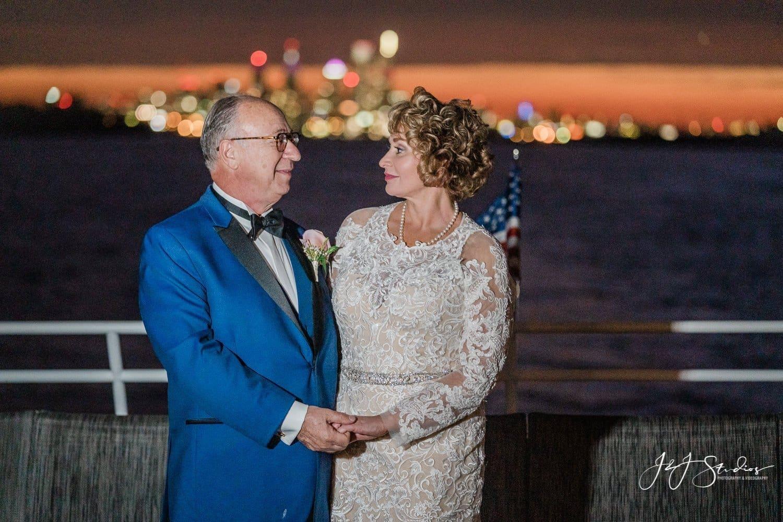 bride and groom on yacht Philadelphia at night