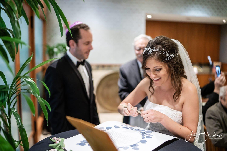 couple at zahav signs A decorated ketubah