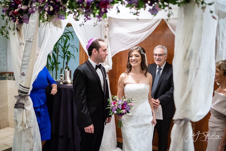jewish wedding couple in chuppah
