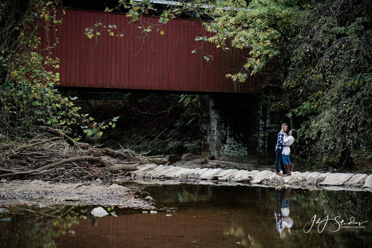 engaged couple under thomas mill covered bridge