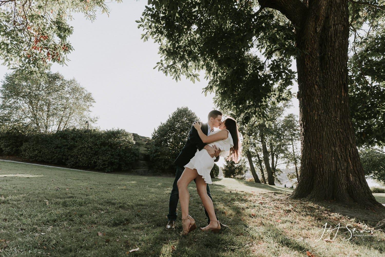 couple dipping at philadelphia art museum engagement photoshoot by j&J studios
