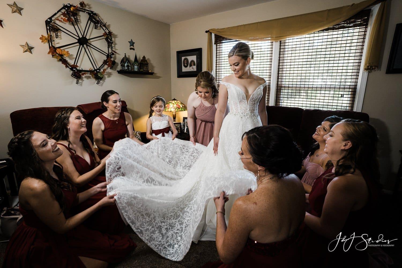 wedding day bridesmaids fluff train ramblewood country club photo by J&J Studios