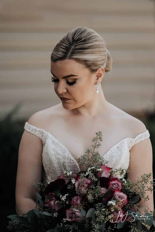 bride in Nadine style wedding dress from Enzoani with wegmans mount laurel flowers ramblewood country club wedding photo by john ryan j&J studios