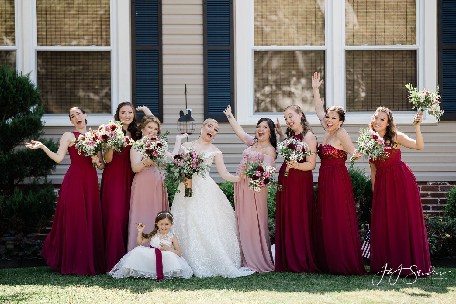 bridal party in front of brides house