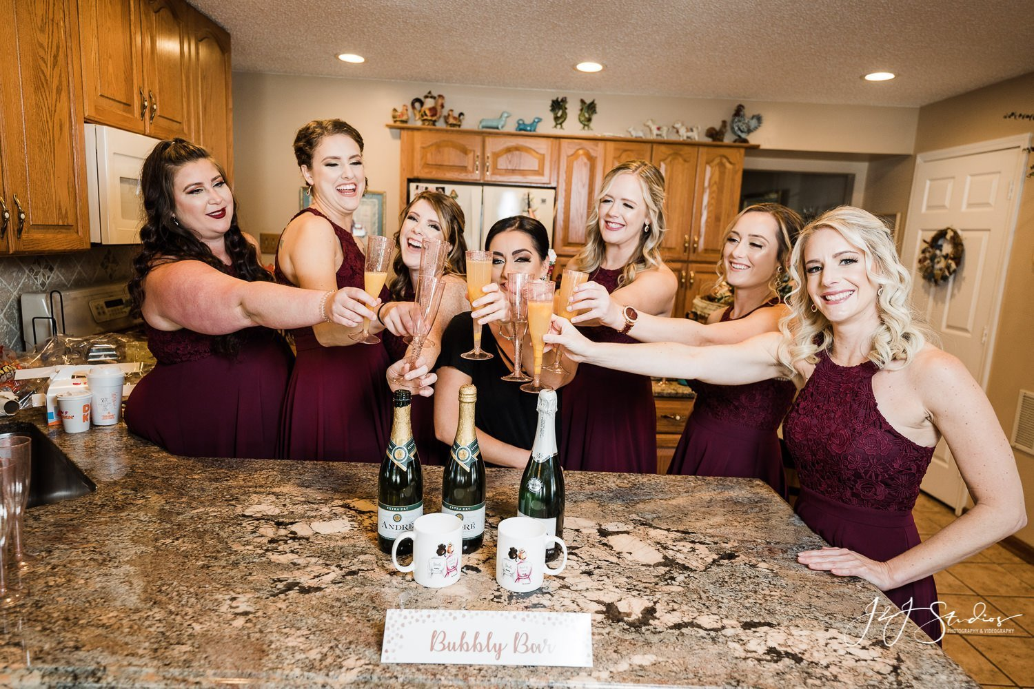 bridesmaids toasting with champagne by j&j studios
