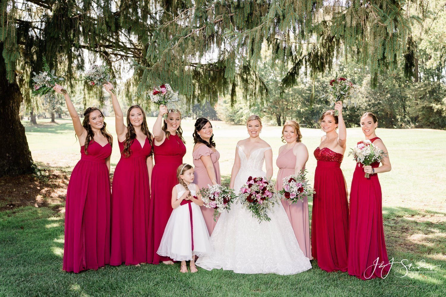 bride and bridal party in red dresses