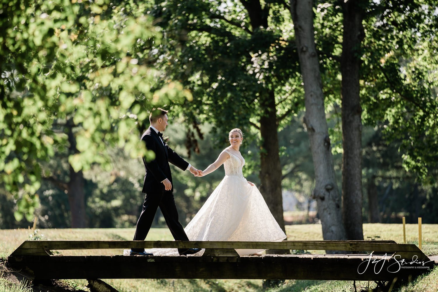 bride leading groom in forest