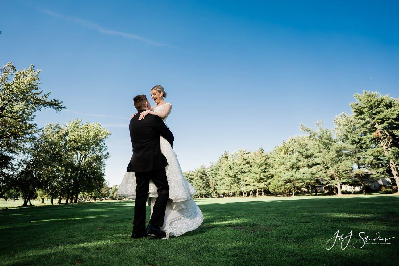 groom picks bride up dirty dancing nod