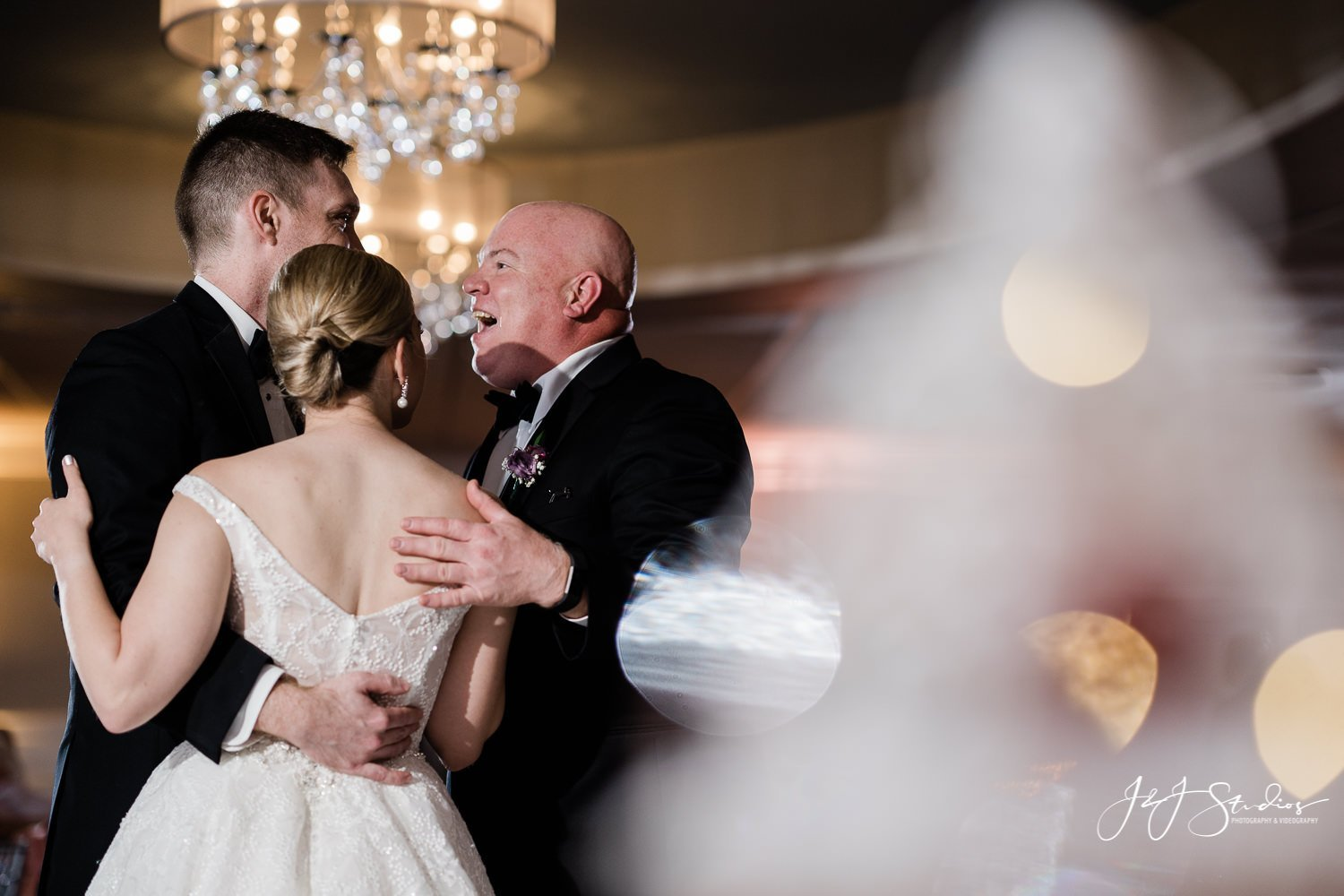 bride, father and groom dance together