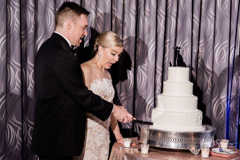 couple cutting cake in nj wedding