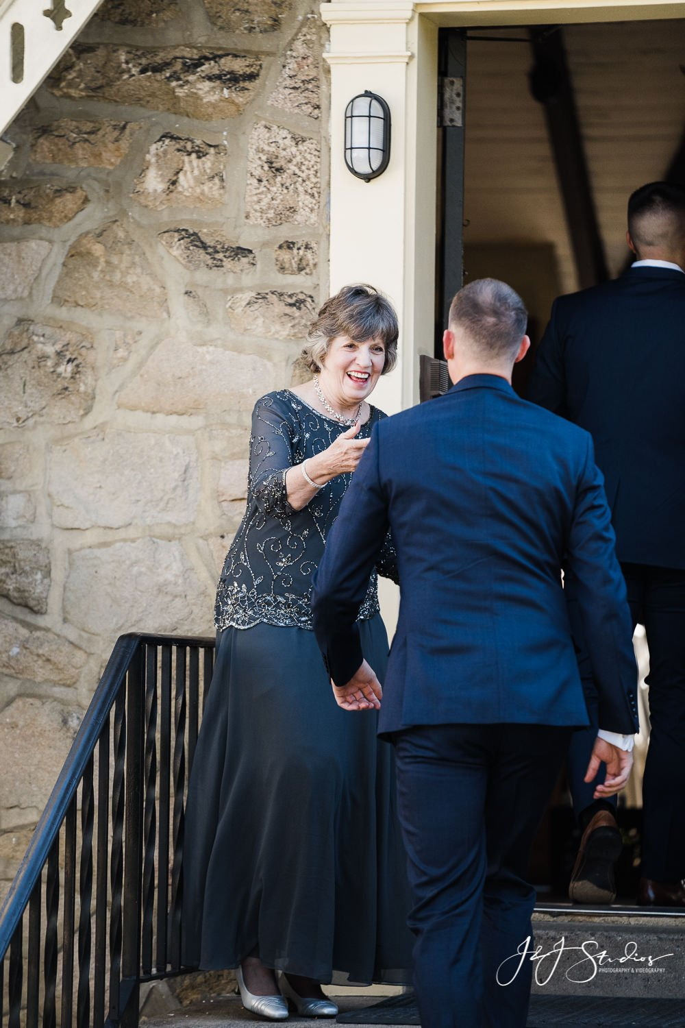mother of the groom sees groom dressed