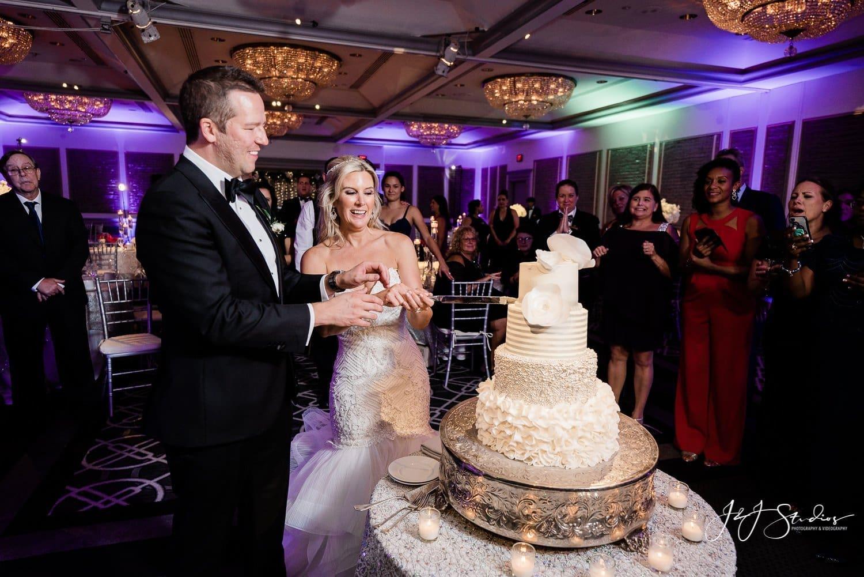 bride and groom cut the cake rittenhouse hotel wedding photo by john ryan J&J studios