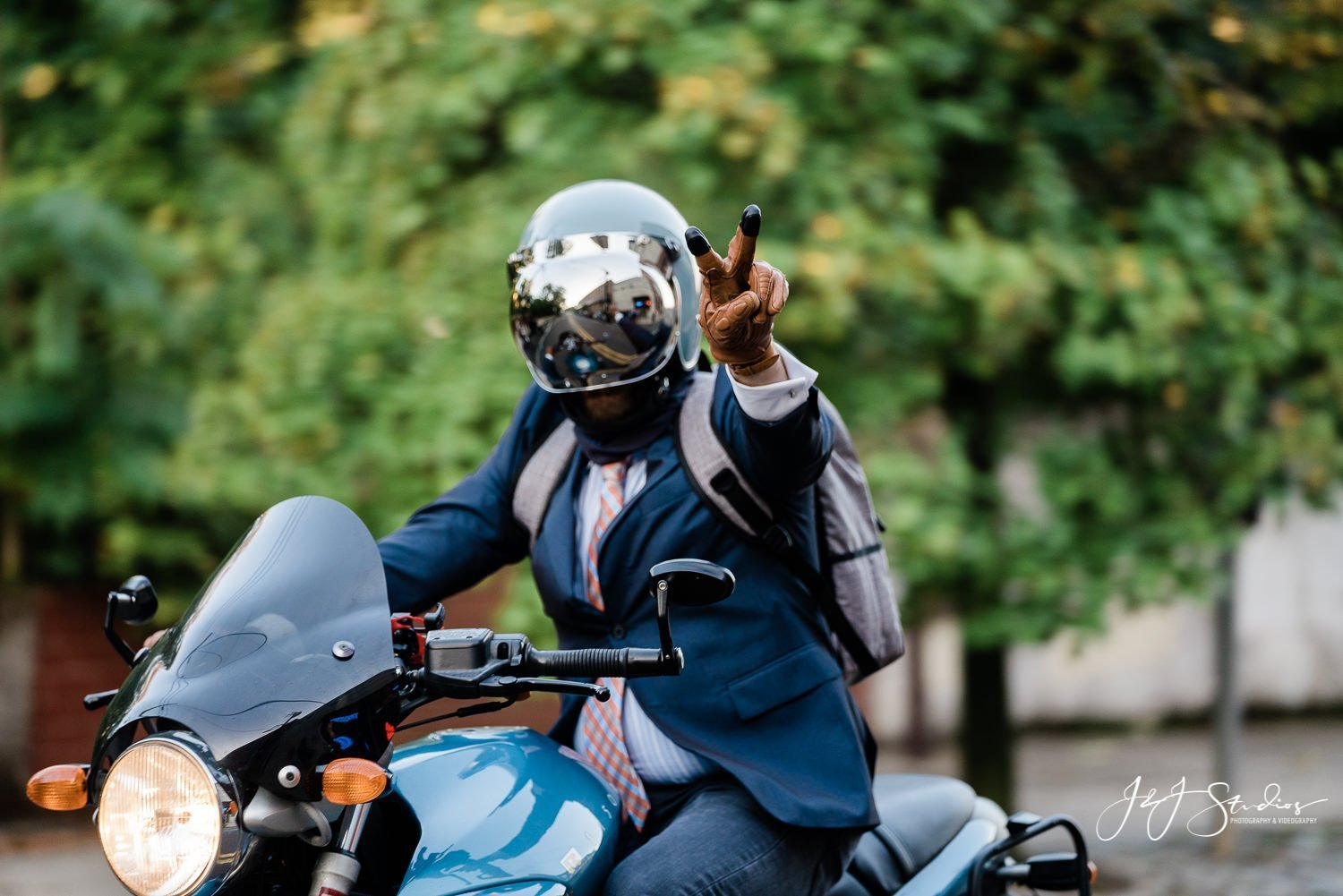 rider in navy suit flashing peace sign dgr 2019