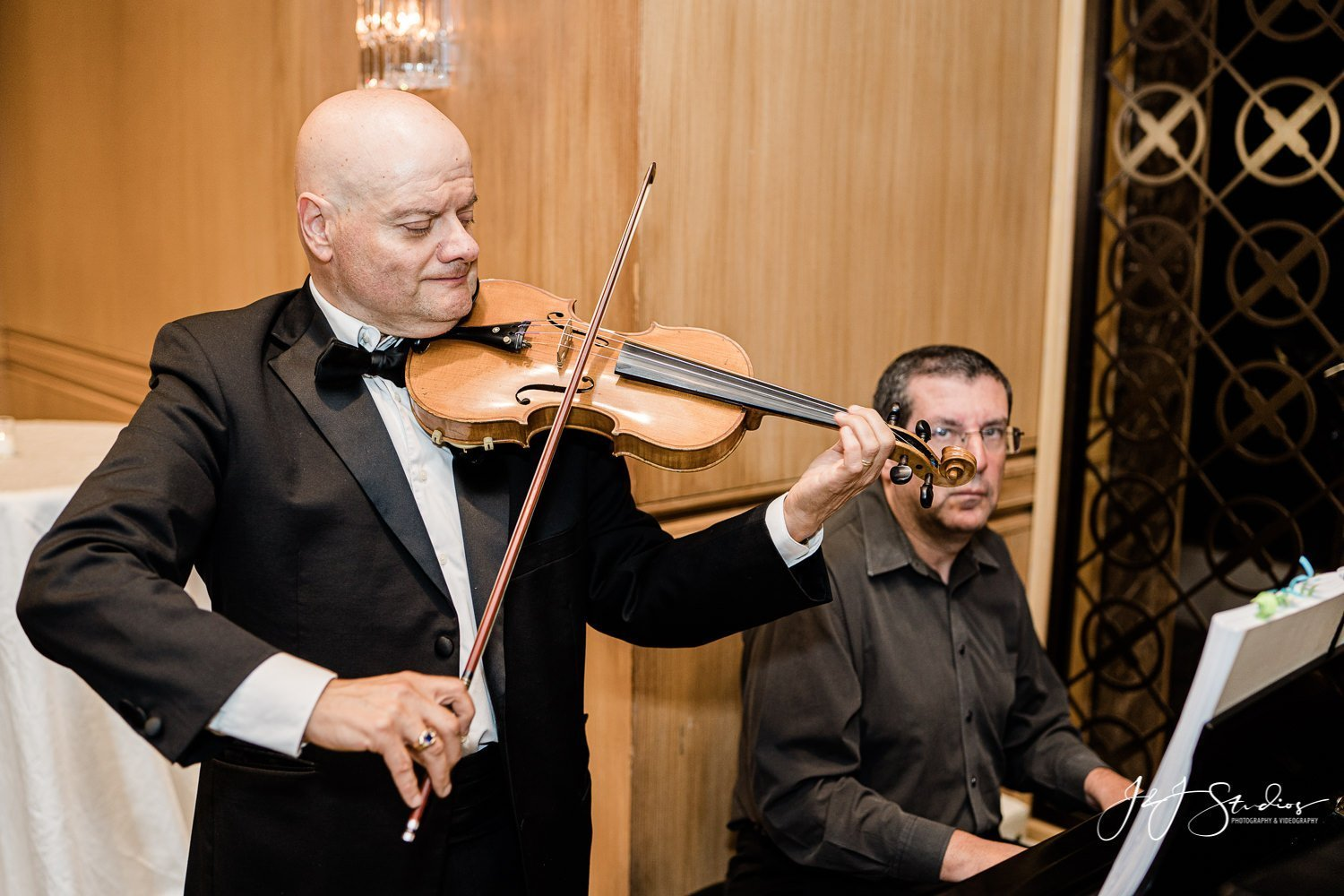 violinist and pianist at rittenhouse hotel wedding