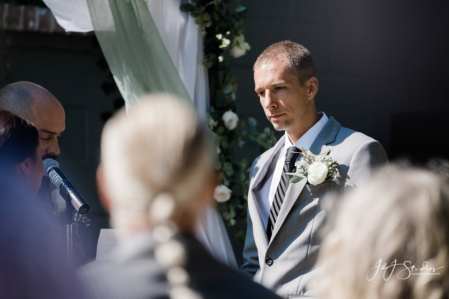 groom says his vows baltimore wedding photographer
