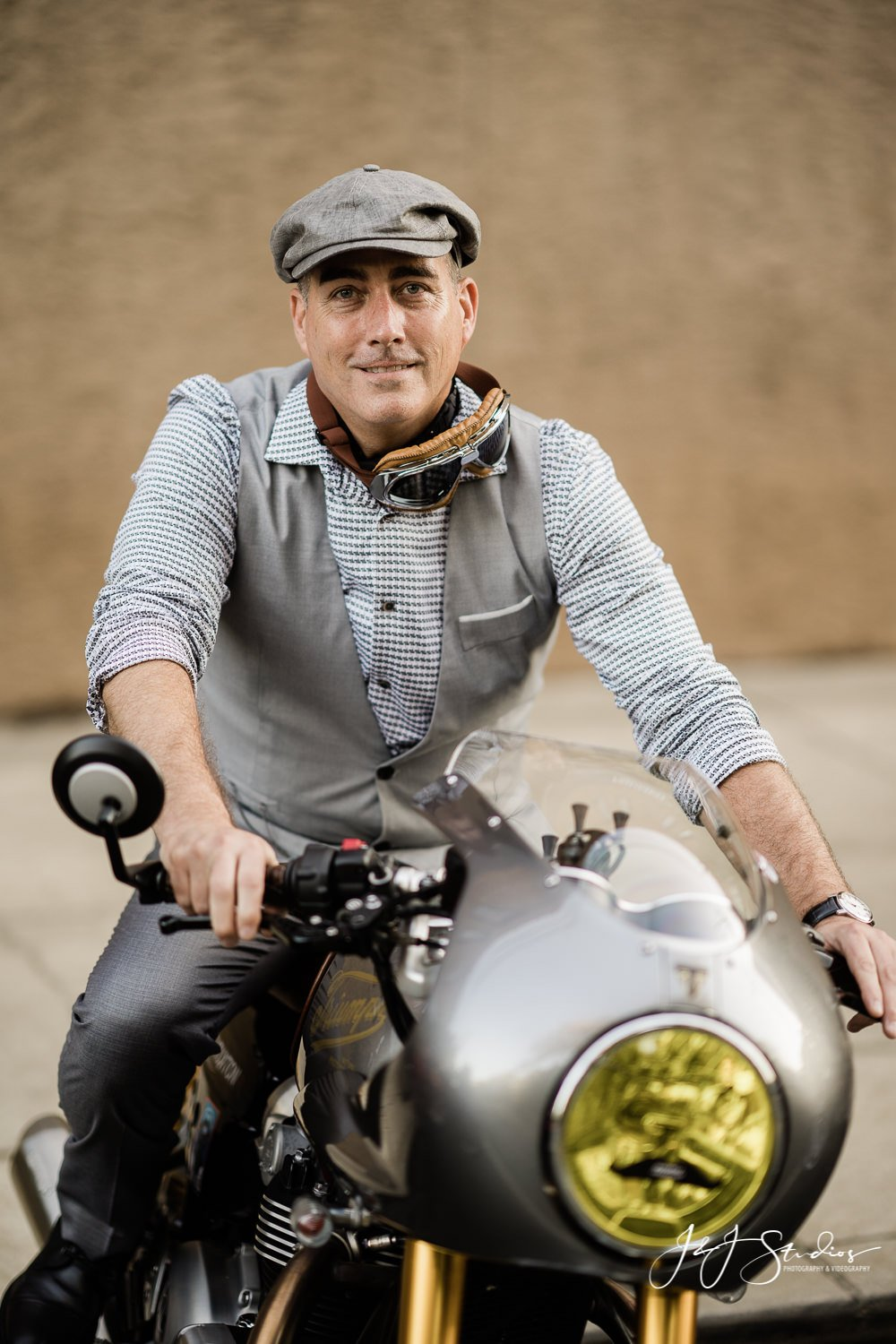 vested man with hat on motorcycle
