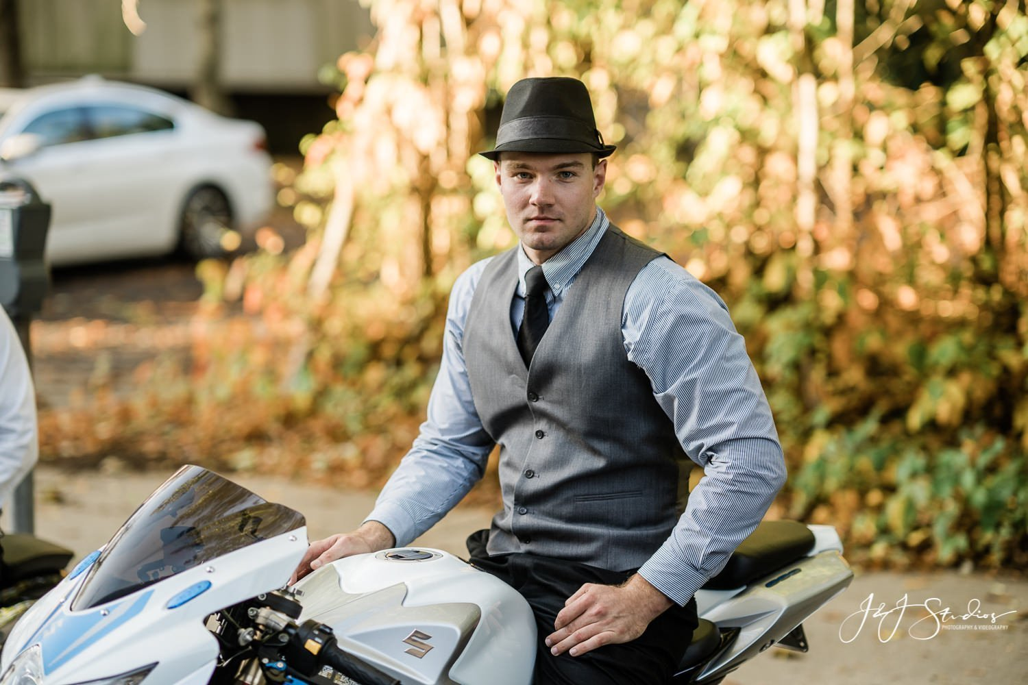 man in fedora on motorcycle
