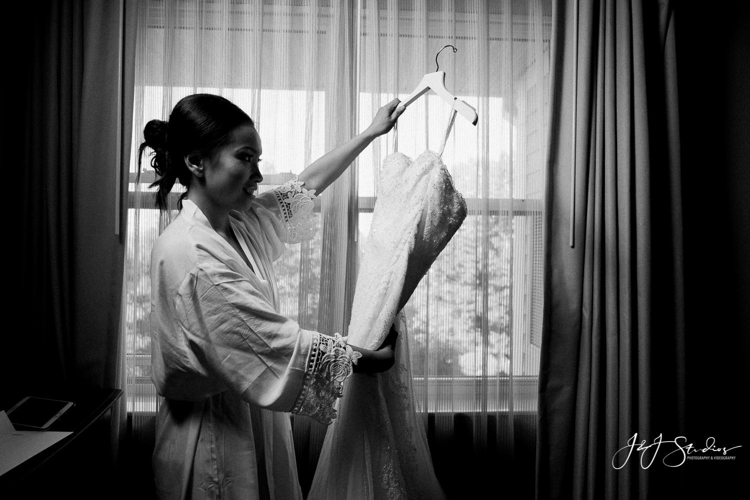 bride holding her dress photo by j&J studios