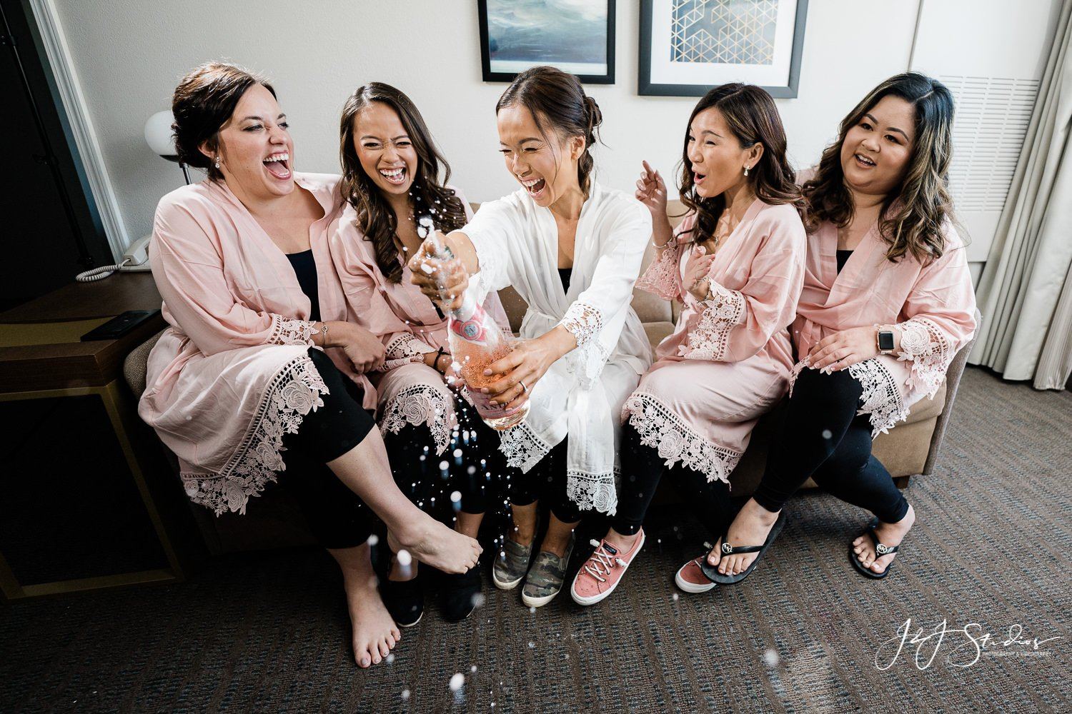 bridesmaids popping champagne bottle Baltimore wedding day