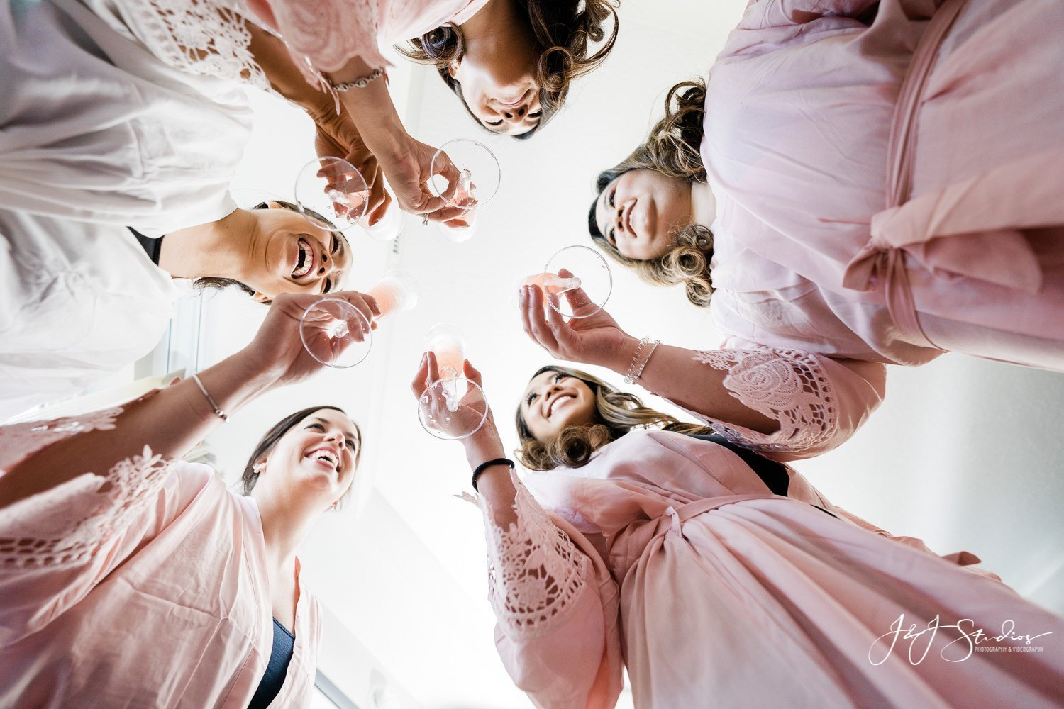 brides cheers during wedding day with champagne