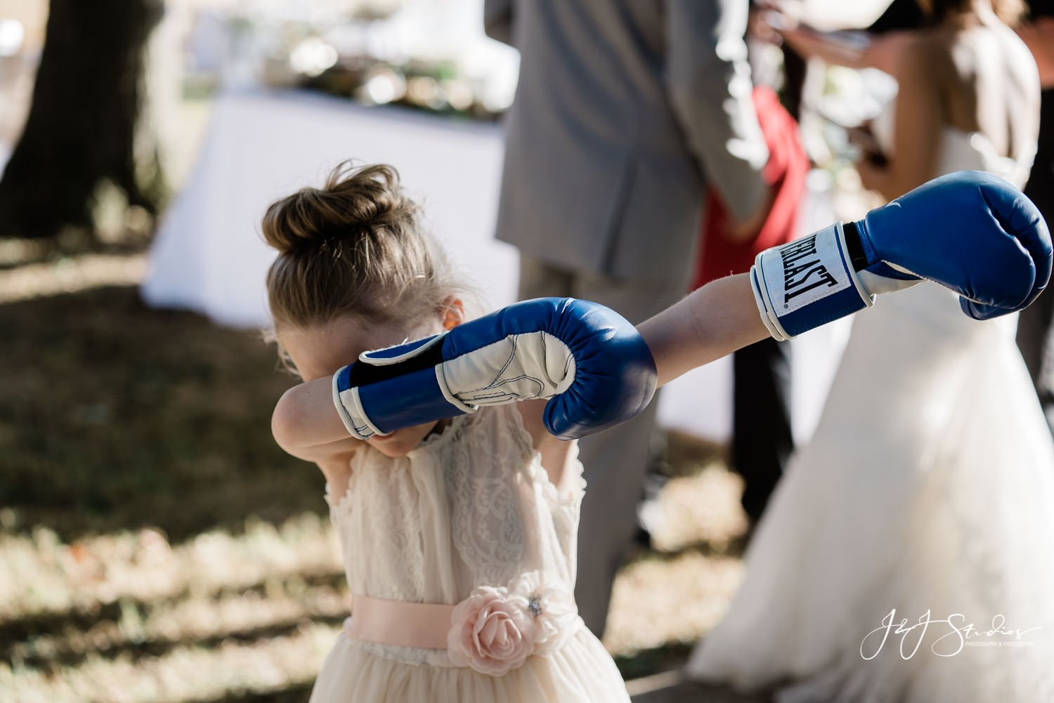flower girl dabbing on dance floor at baltimore wedding reception photo by j&J studios
