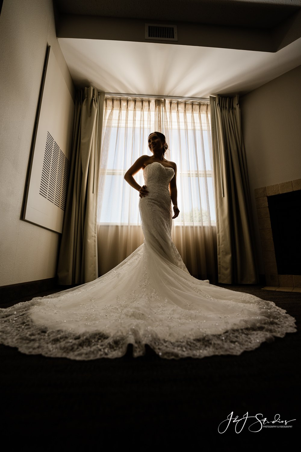 silhouette of bride by window baltimore wedding photographer