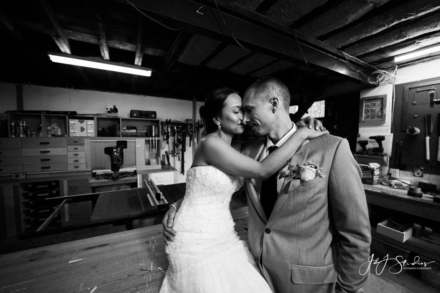Bride and groom portrait in groom's workshop