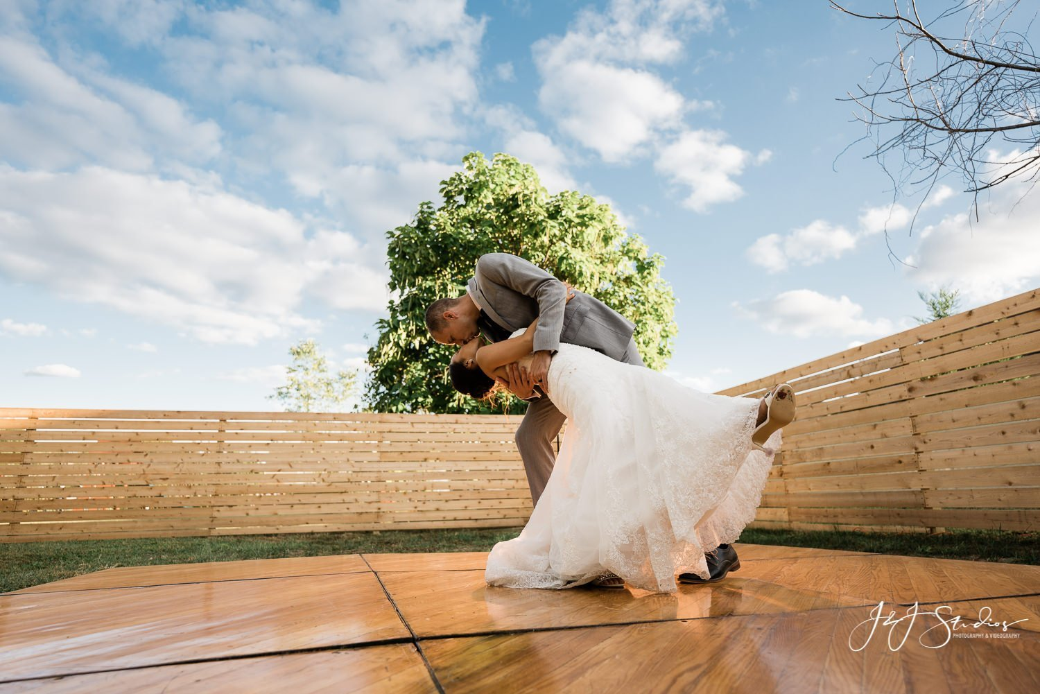 bride and groom dip on dance floor baltimore wedding photographer