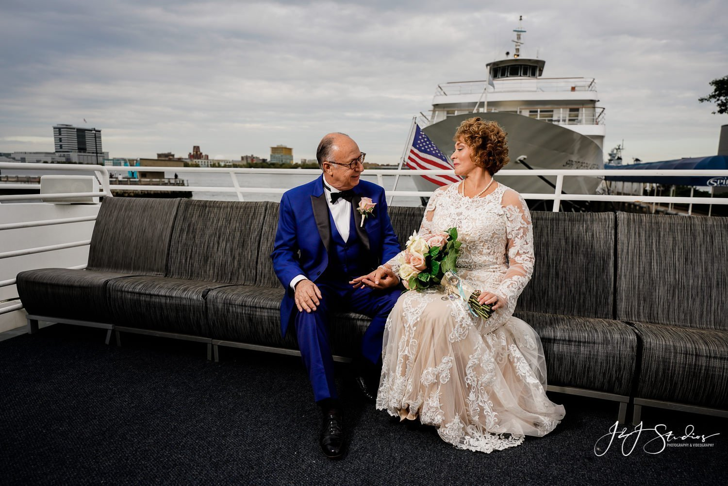 bride and groom on deck of freedom elite private yacht wedding