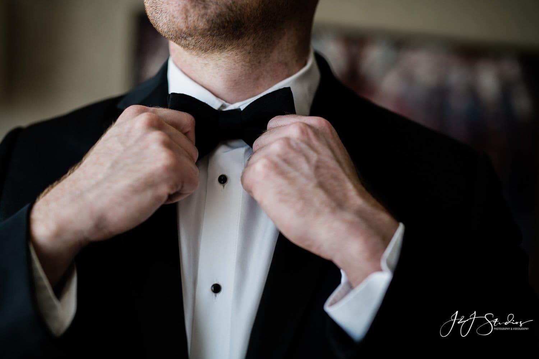 BLACK By Vera Wang Black Notch Lapel groom on ramblewood country club wedding day photo by j&J studios