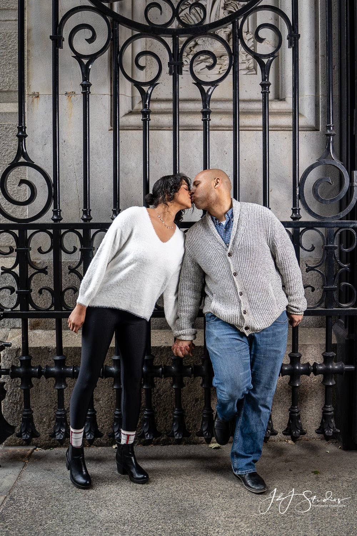 iron gate philadelphia city hall couple kiss