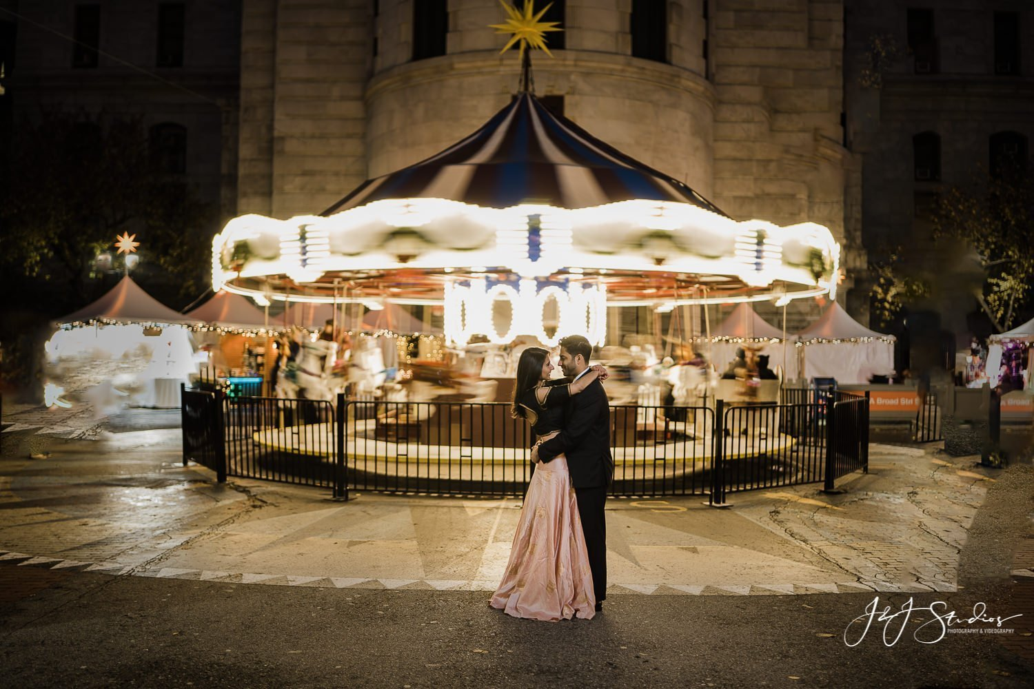 carousel winter philly city hall engagement picture