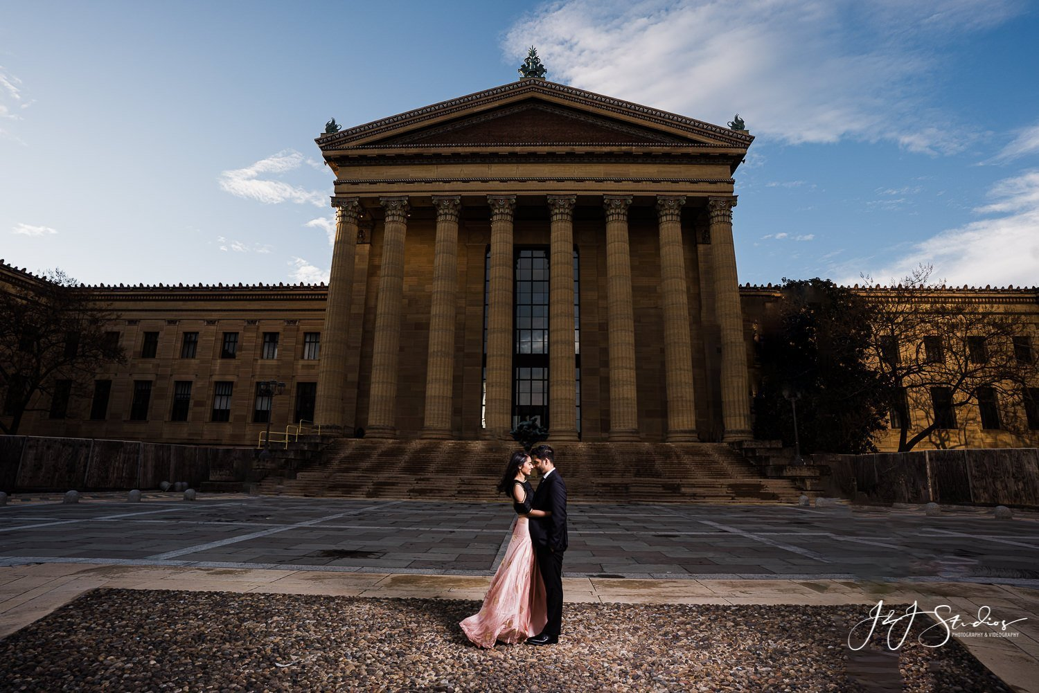 front of art museum philly engagement session
