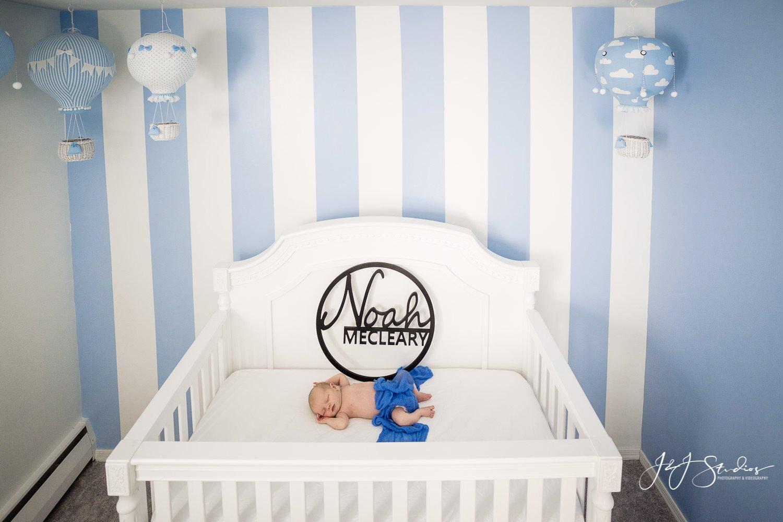 baby in nursery best philly newborn photographer