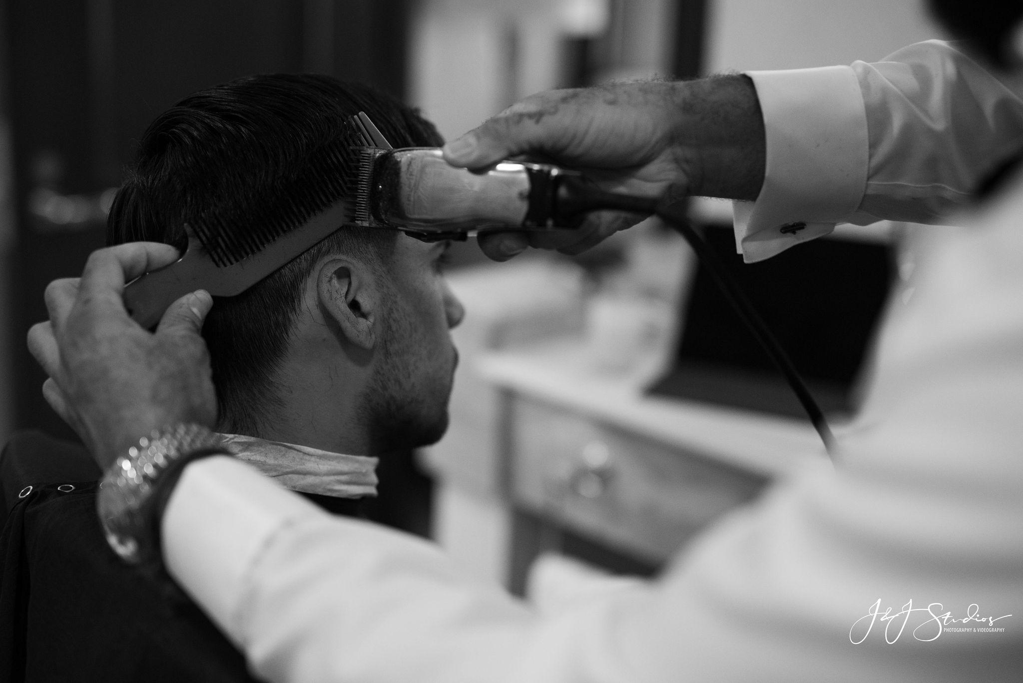 groom gets haircut