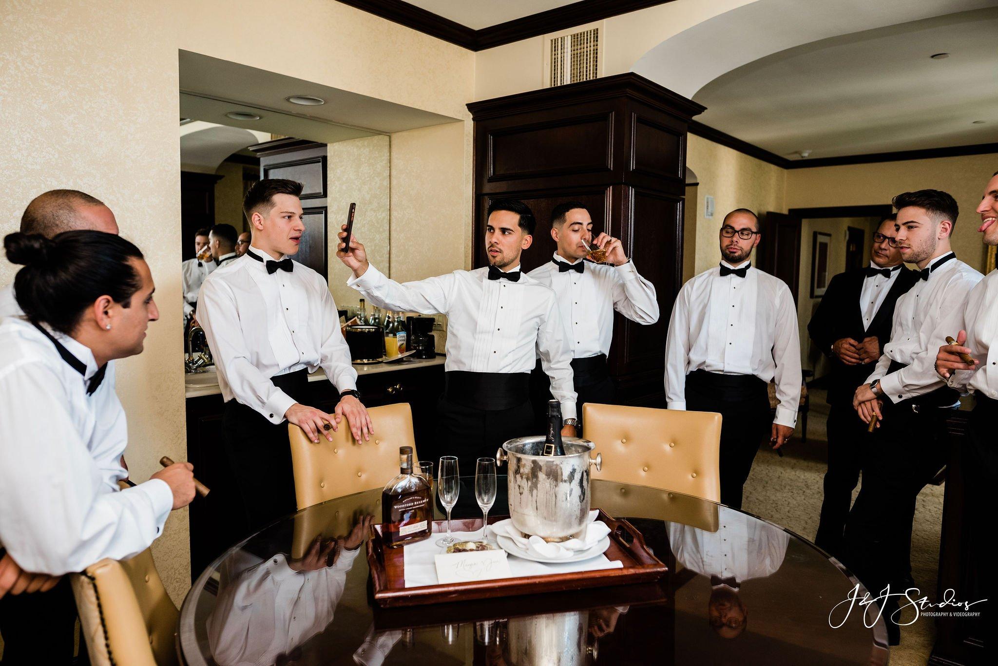 groom and groomsmen cigars hotel dupont