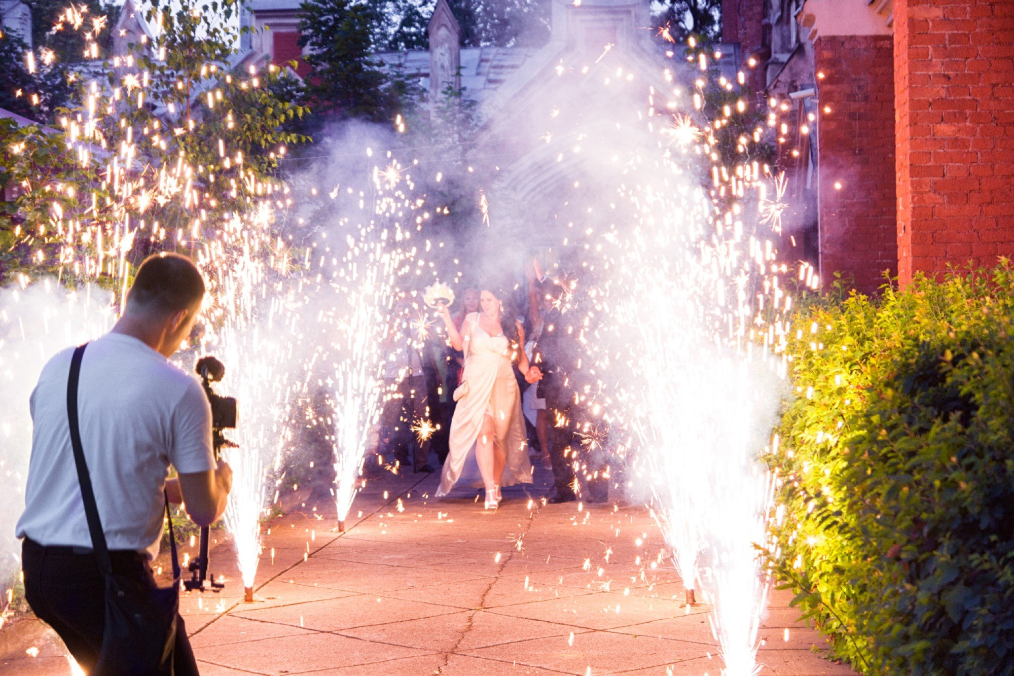 Taking a picture of a woman with sparklers