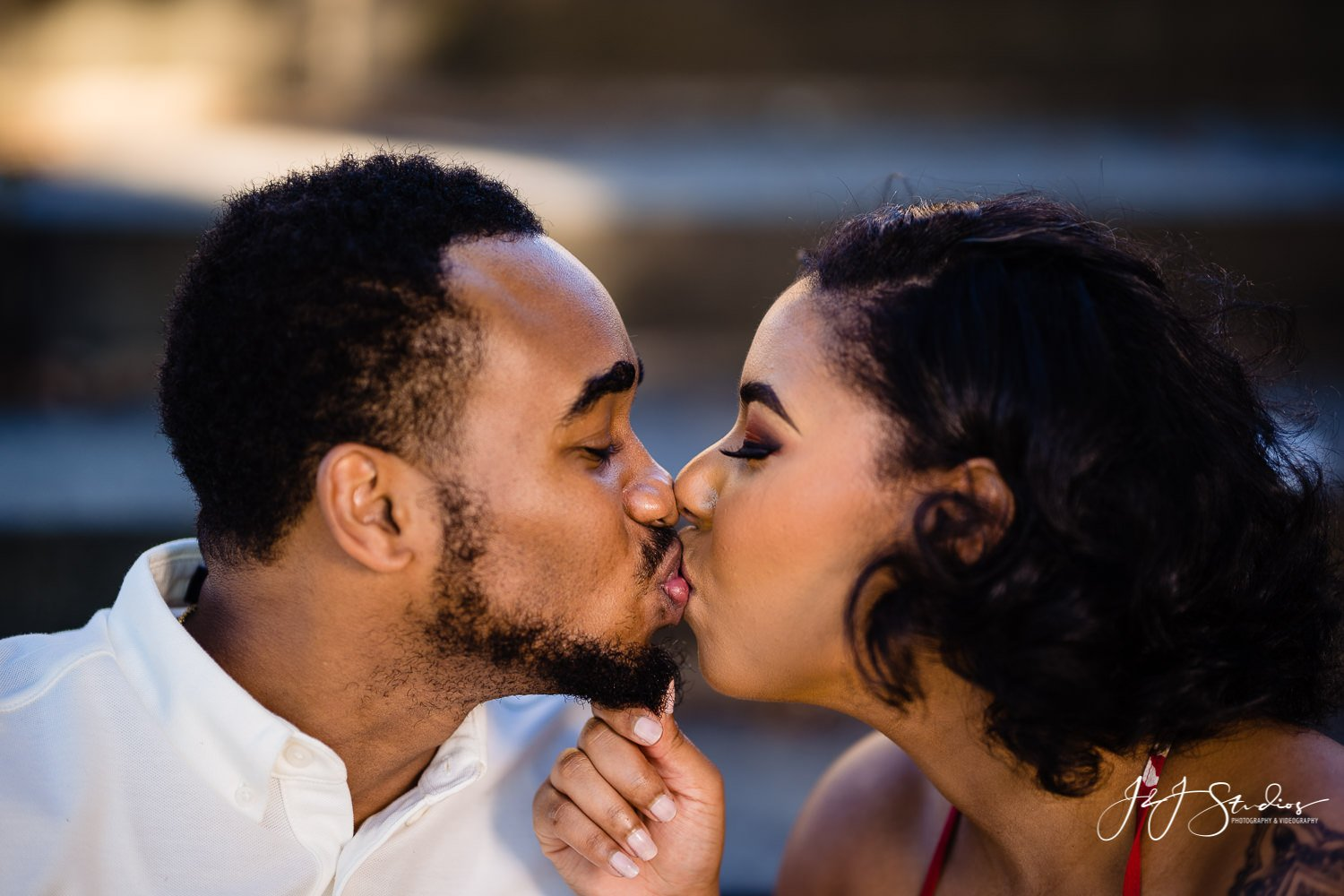 black couple kissing philly engagement