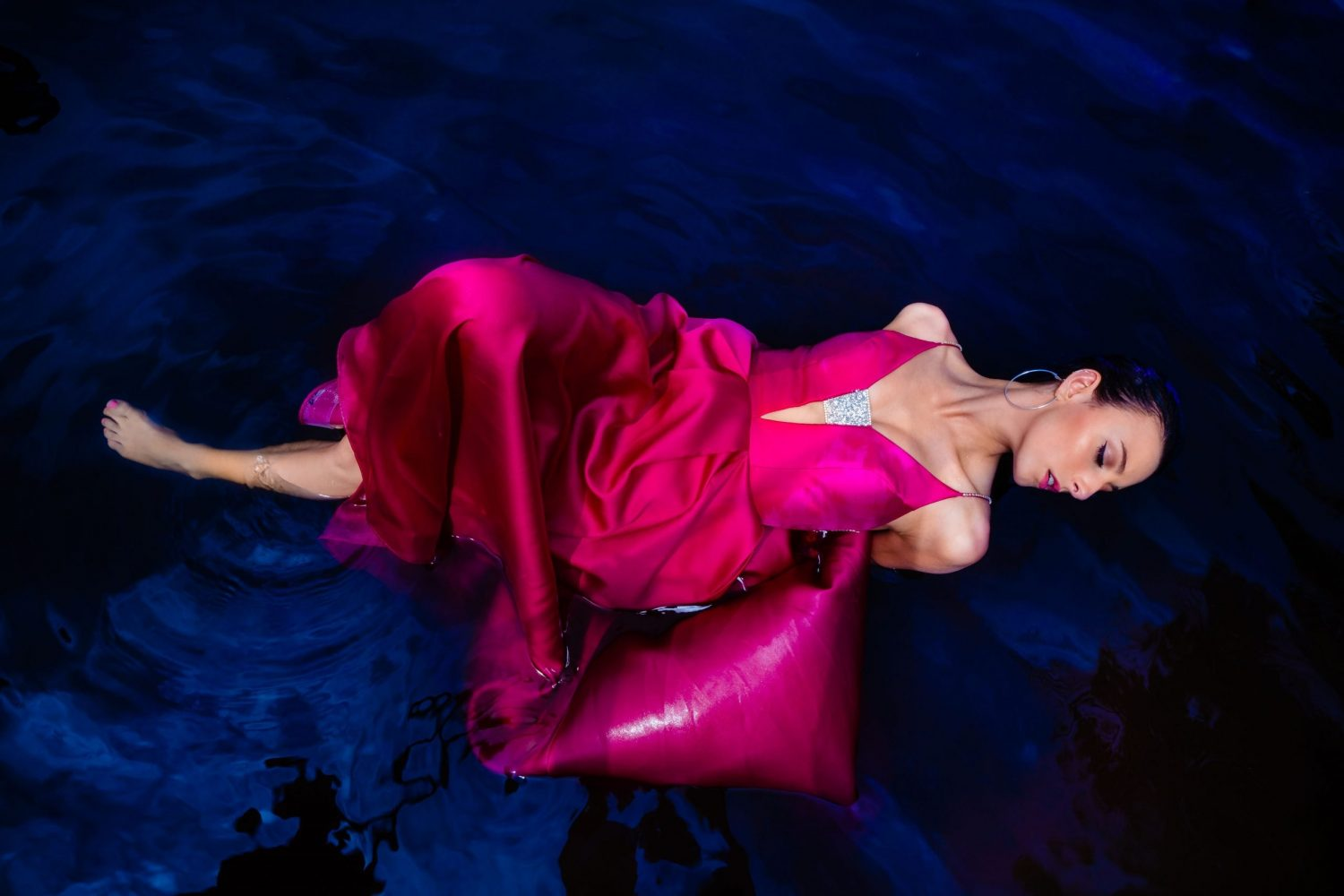 hot pink prom dress in water in Philly
