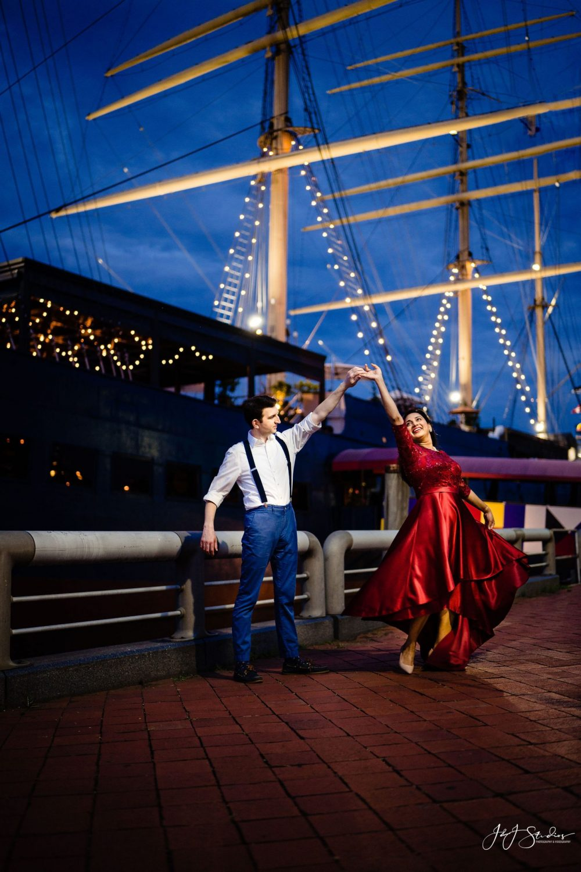 guy twirling girl dancing moonlight