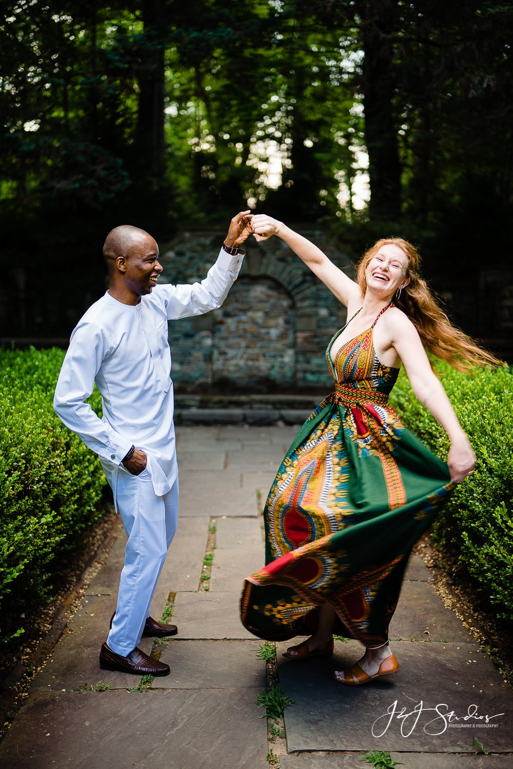 Earthy dress white outfit dancing smiling red hair Hunting Hill Mansion